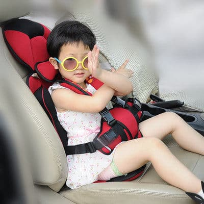 baby in 5 point harness car seat
