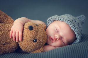 when can baby sleep with stuffed animal