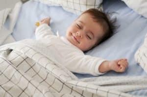 baby sleeping on cot